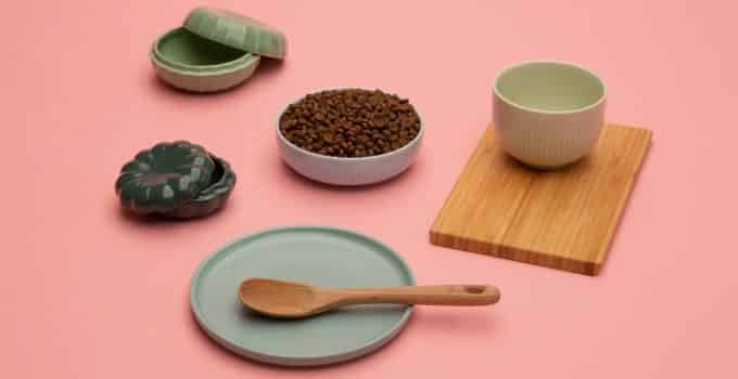 Brown digest sensitive food for cats placed on a pink table